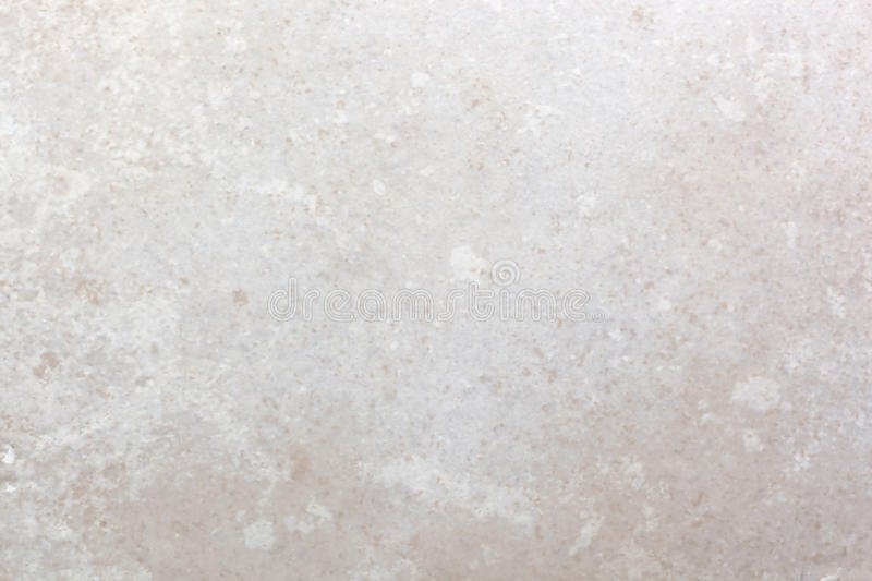 Ceramic Tile Macro Background. Macro of single ceramic tile, in shades of peach, white and gray. Useful background textures royalty free stock image