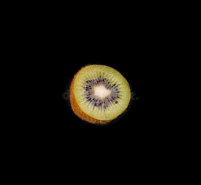 Macro of sliced kiwi fruit on black. Background royalty free stock photos