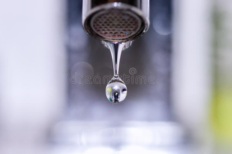 Macro of a tap water droplet. A Macro of a tap water droplet royalty free stock images
