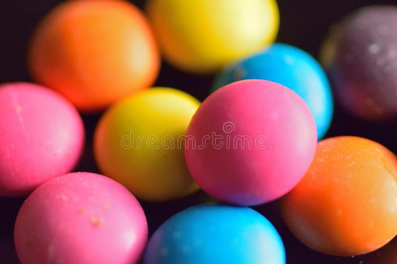Macro texture of colorful sugar coated candies. In horizontal frame stock photo