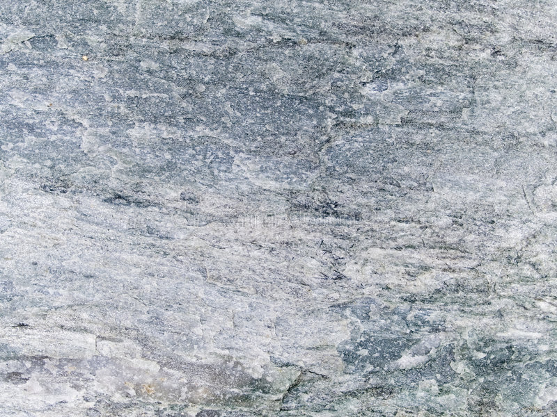Macro texture - stone - discolored. Stock macro photo of the texture of rough stone. Useful for layer masks or abstract backgrounds royalty free stock image