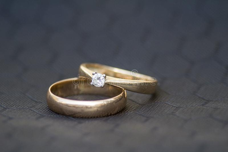 Wedding rings. ring with breients. Gray background. gray honeycomb. macro. macro two rings. macro two rings. stock photos