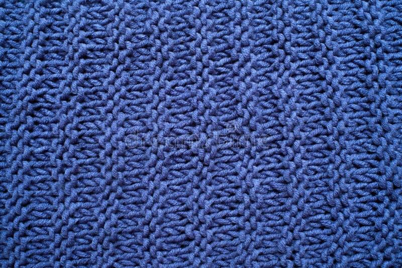 Macro van een wollen blauwe sweater Breiend patroon royalty-vrije stock foto