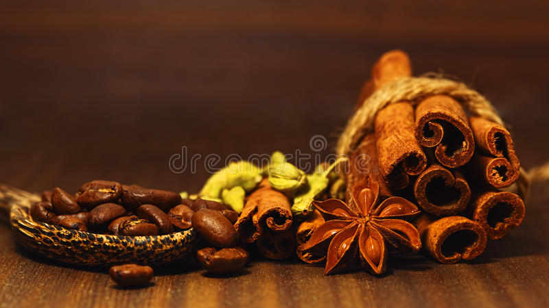Macro of variety of spices and coffee beans on the table stock photography