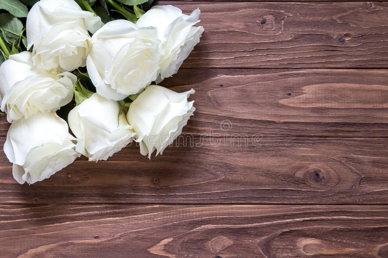 Download Macro View Of Beautiful White Roses Bouquet On The Corner Wooden Table