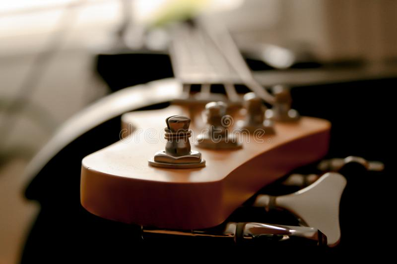 Macro view of a Headstock of an electric bass guitar stock photo