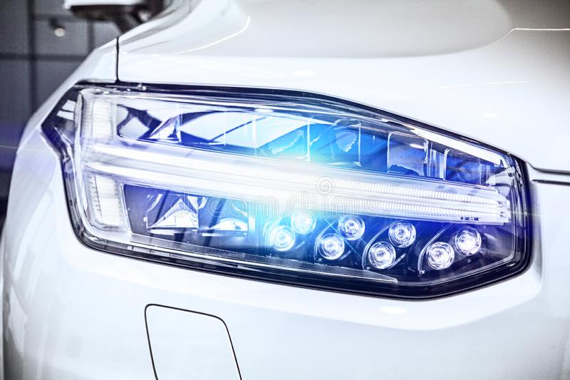 Macro view of modern car headlight SUV with noise graine effect. car xenon lamp headlight. detail view on car xenon lamp stock photos