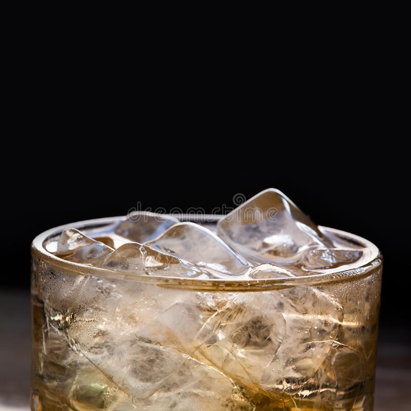 Glass With Ice Cubes. Black Background. Macro Stock Photo