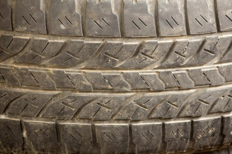 Close View of an old tyre with grooves and patterns royalty free stock photography