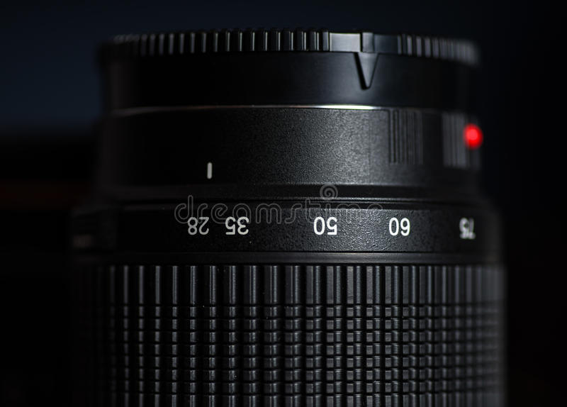 Macro view of photo lens. Macro view of photographic lens with digits stock photos