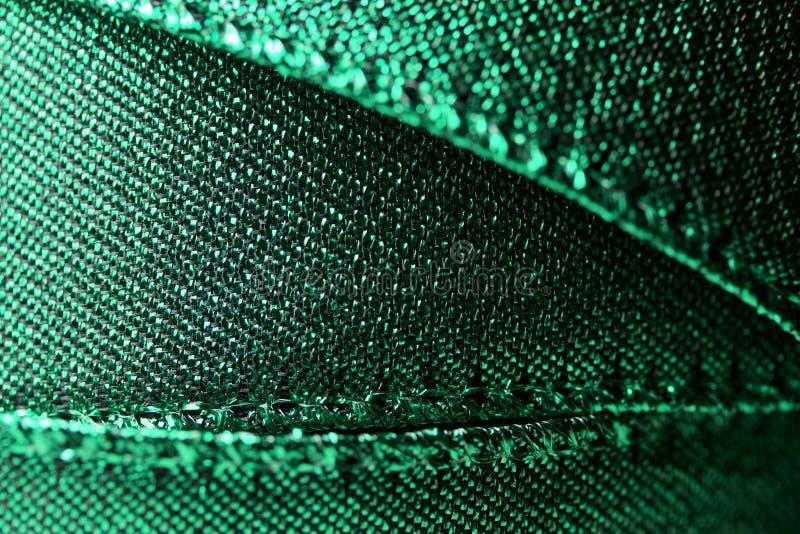 Macro view of shimmering green fabric ribbon texture royalty free stock photos