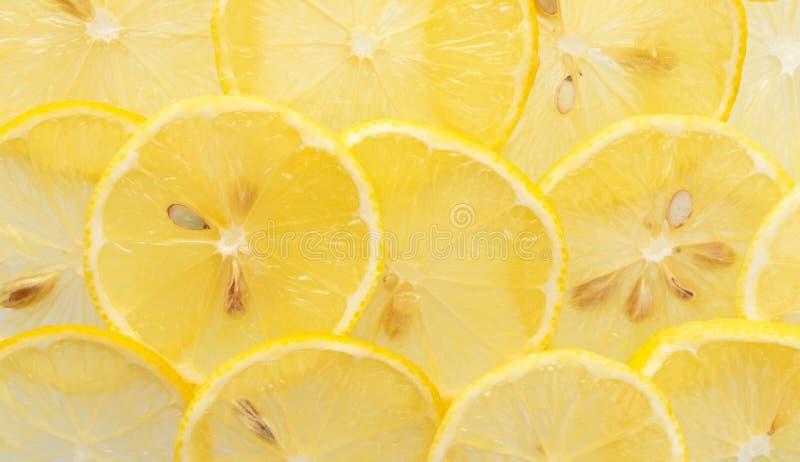 Macro yellow lemon slices pattern, top view. Fresh juicy food concept, banner. Format stock photo
