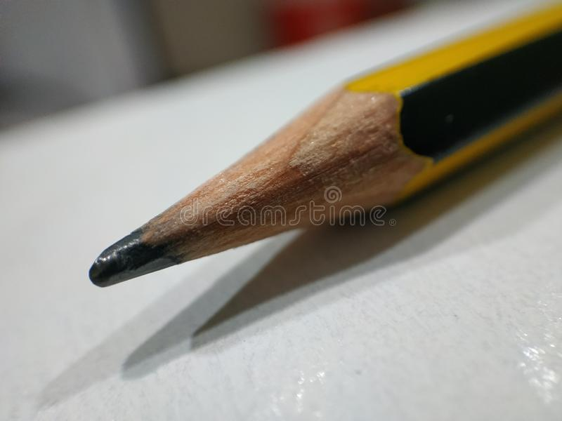 Macro zoom  image  of a pencil  tip. Macro image of pencil tip showing detail of carbon tip of a pencil stock photos