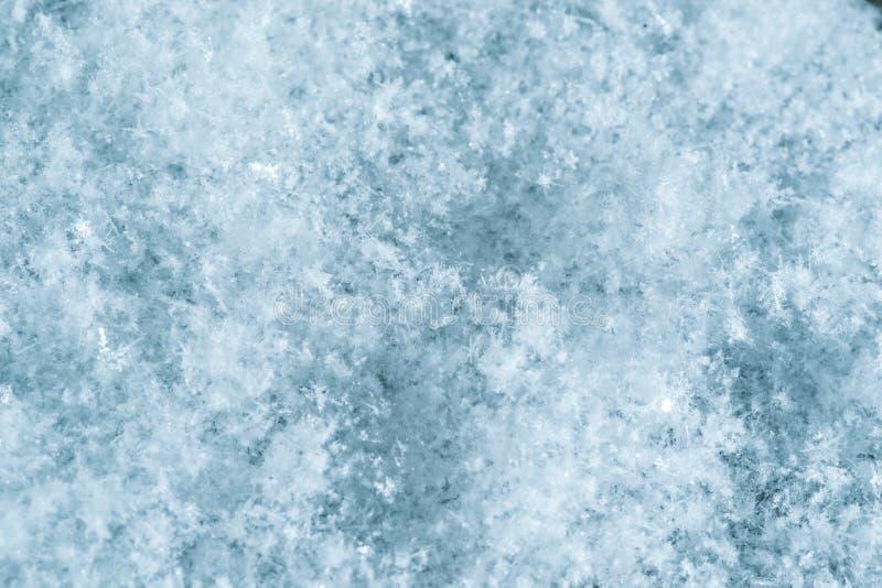 Macrobeeld van sneeuwvlokken De achtergrond van de winter stock fotografie