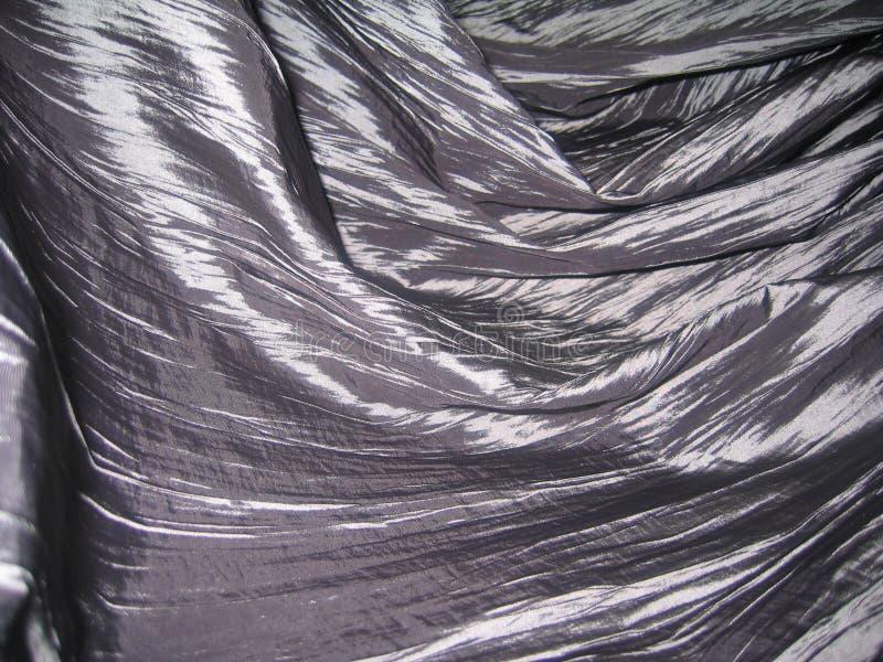 Macrofotografia dei drappi del tessuto di seta fotografia stock libera da diritti