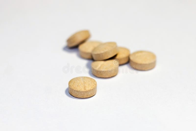 Macrofotografie van tabletten en vitaminen stock afbeelding