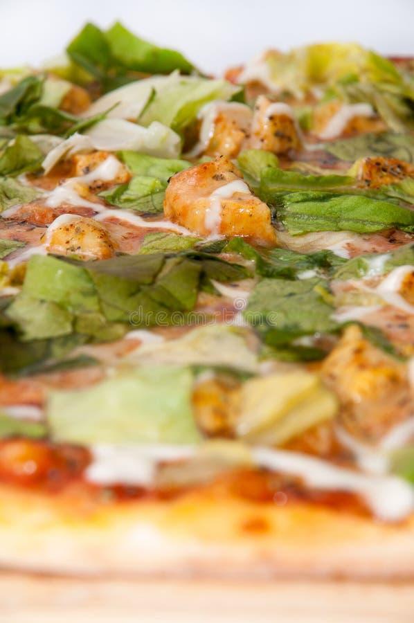 Macromening van pizza met groene letuce stock foto