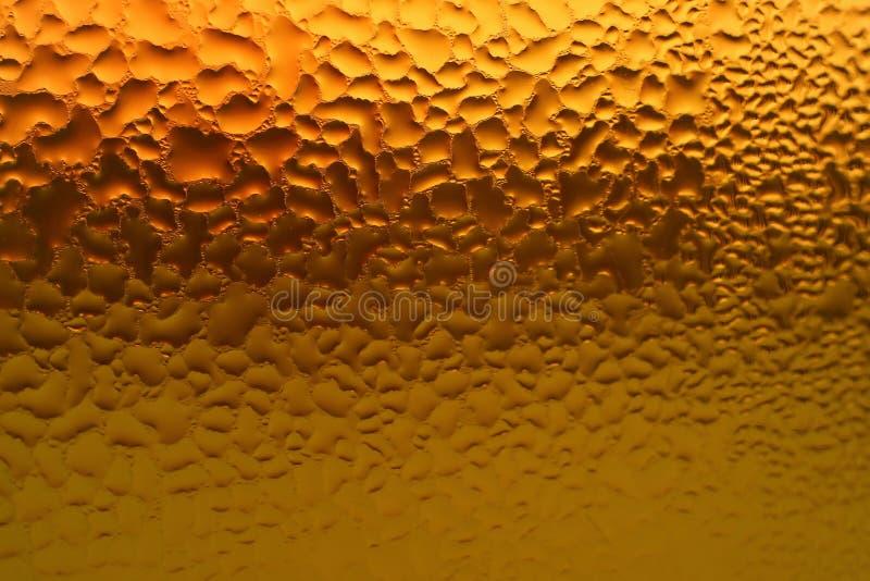 Macroschot van condensatie op het flessenhoogtepunt van gemengd kruidensap royalty-vrije stock foto