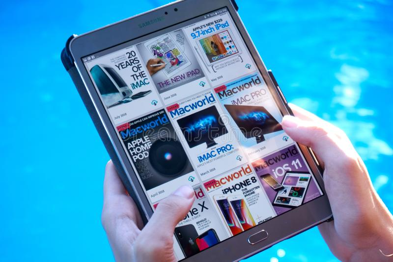 MacWorld magazine on a Samsung Galaxy tablet screen. MONTREAL, CANADA - SEPTEMBER 8, 2018: MacWorld magazine on a Samsung Galaxy tablet in hands stock photo