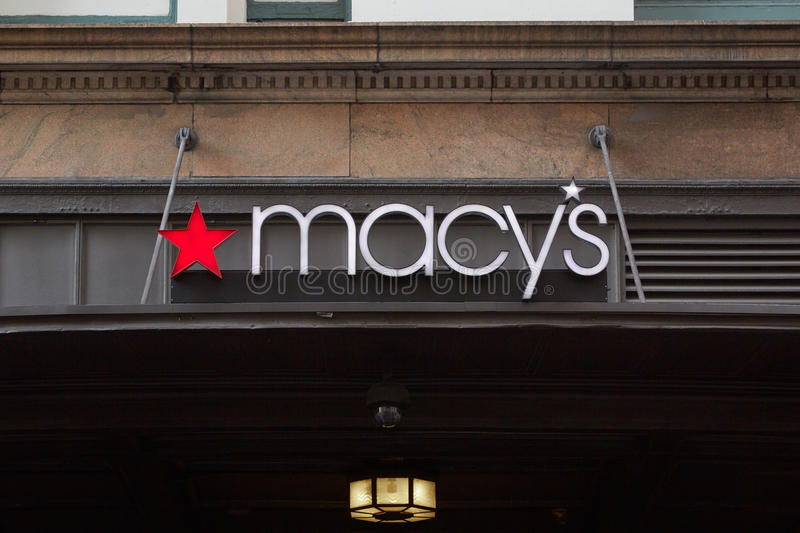 Macy`s department store sign Midtown Manhattan, New York. NEW YORK - SEPTEMBER 10: Macy`s department store sign in Herald Square flagship location in Midtown royalty free stock photo