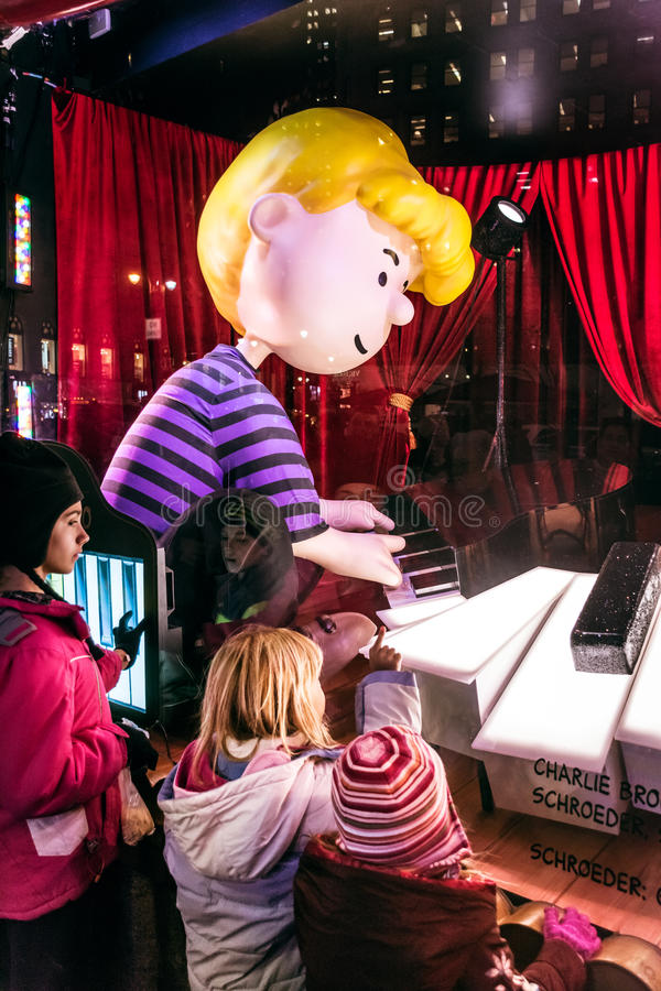 Macy's Peanuts Window. NEW YORK-DECEMBER 21: The Macy's Christmas window display theme was Charlie Brown on December 21 2015 in New York City stock photography