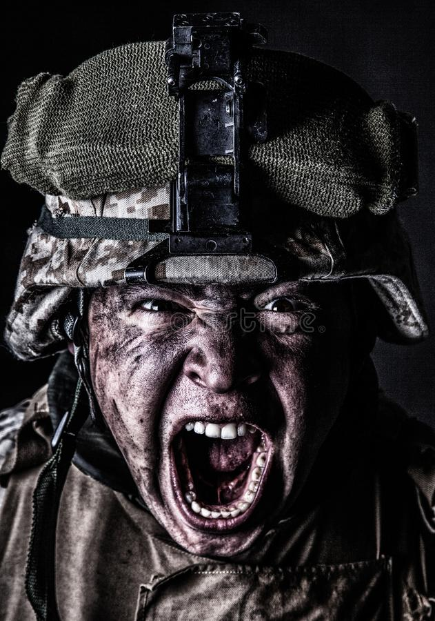 Mad army soldier screaming while looking at camera royalty free stock photo