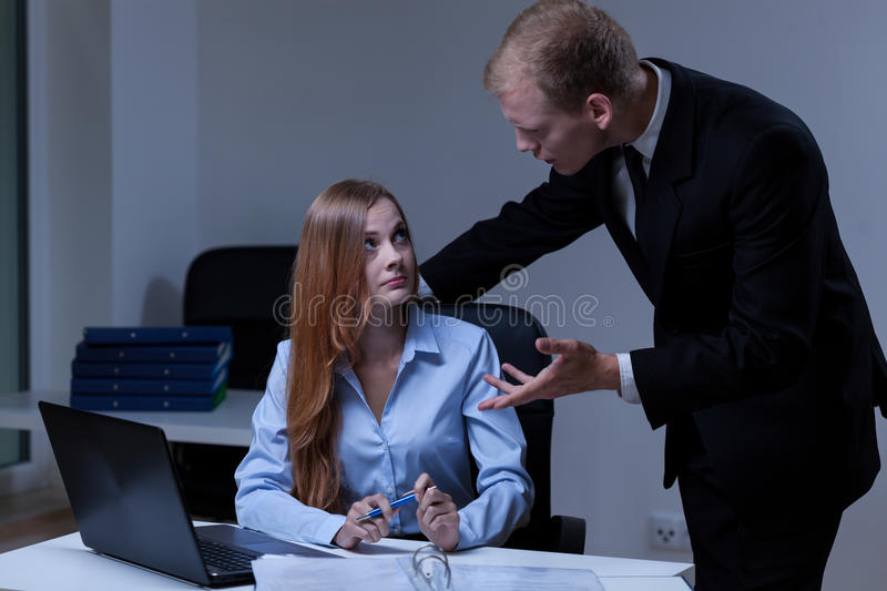 Mad boss talking with worker. Mad boss talking with female worker, horizontal stock image