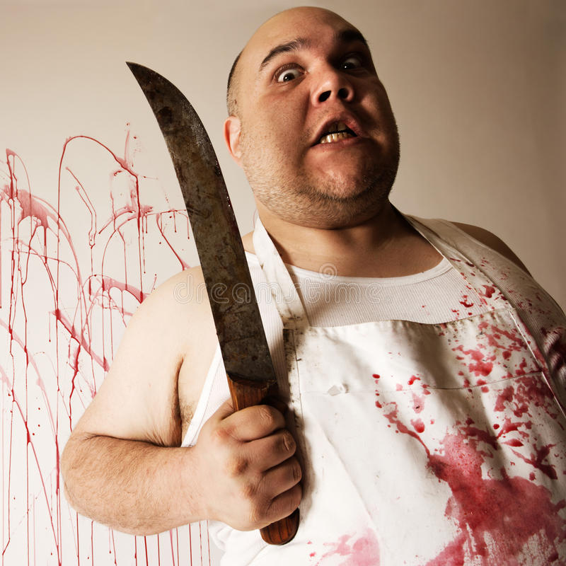 Mad butcher with knife stock image