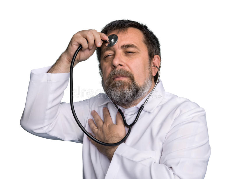 Mad doctor with a stethoscope stock photo