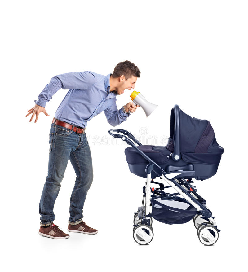 Mad father yelling to his baby. A mad father yelling to his baby laid down in a baby carriage on white background royalty free stock photo