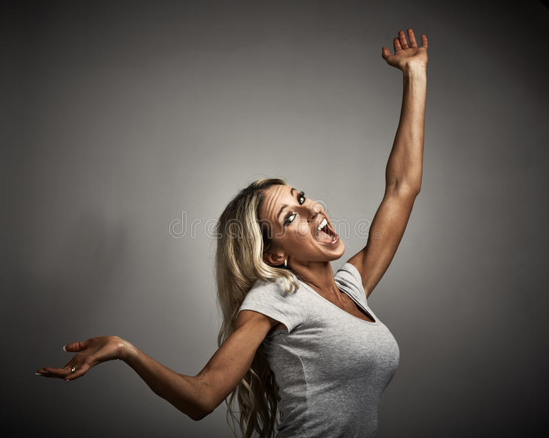 Mad girl. Young happy excited laughing crazy mad woman portrait stock photo