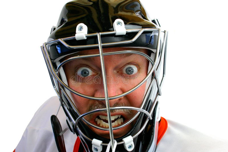 Mad Hockey Goalie. This is a face close-up of a mad hockey goalie stock photos