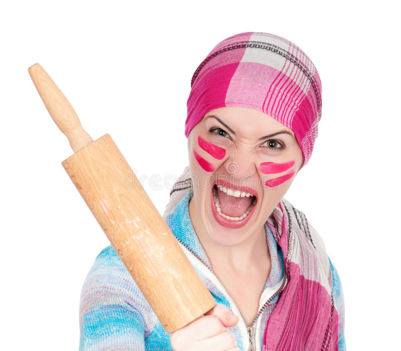 Mad housewife. With rolling pin on white background stock image