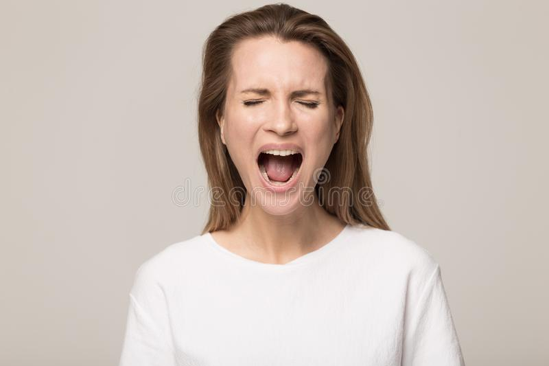 Mad millennial woman feel displeased scream loud stock image