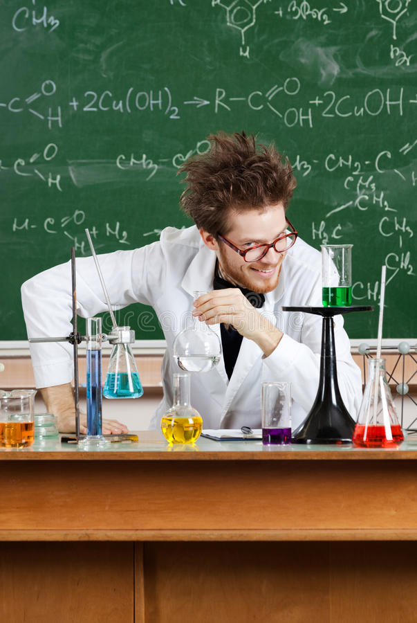 Mad professor laughs. In his laboratory royalty free stock photo