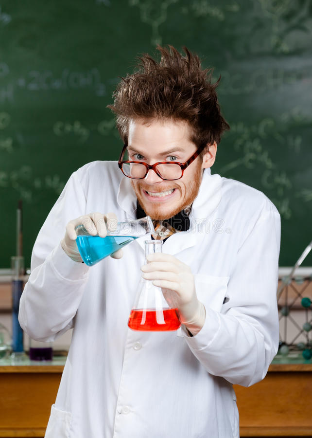 Download Mad Professor Pour Blue Liquid Stock Photo - Image of adult, glass: 26983644