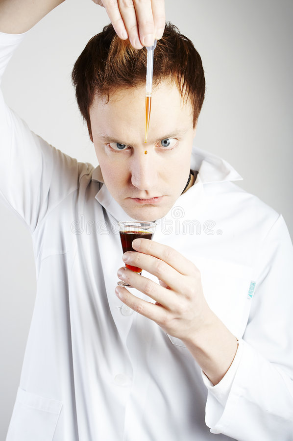 Mad scientist. Mixing a drink royalty free stock image