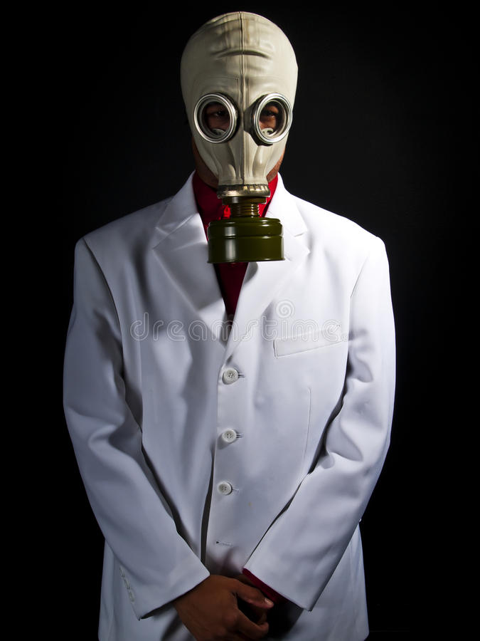 Mad scientist. Wearing a gas mask and a lab coat stock photos