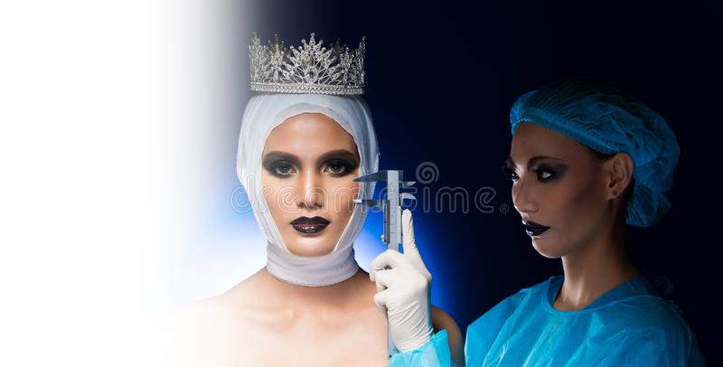 Mad woman Doctor acting surgery on face Patient. Mad women Nurse Doctor acting plastic surgery, check, diagnose, test on face of Beauty Aesthetic Miss Beauty stock image