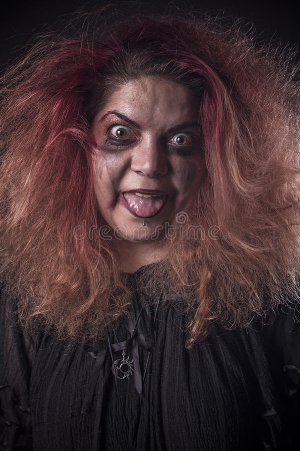 Mad woman looking scary. Deranged girl with a dangerous face royalty free stock images