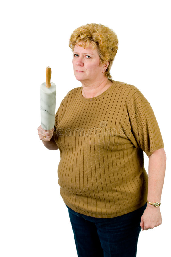 Mad woman with rolling pin royalty free stock photography