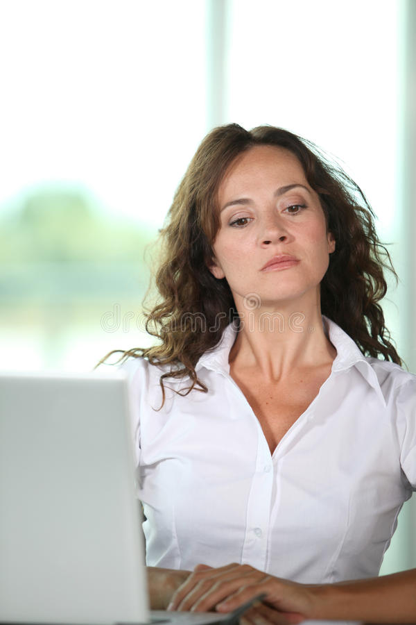 Mad woman at work royalty free stock images