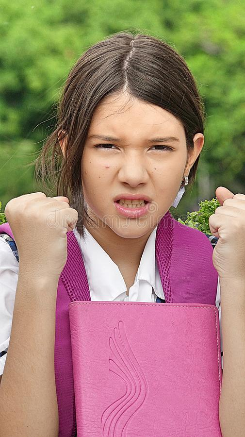 Mad Young Colombian Female Student. A pretty young Colombian teen girl royalty free stock photo