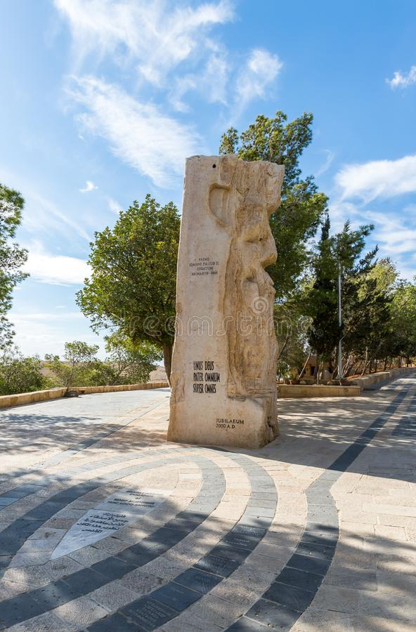 Stone monument dedicated to the visit of Pope John Paul II Memorial Church of Moses on Mount Nebo near the city of Madaba in Jorda stock photos