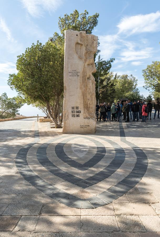 Stone monument dedicated to the visit of Pope John Paul II Memorial Church of Moses on Mount Nebo near the city of Madaba in Jorda stock photo
