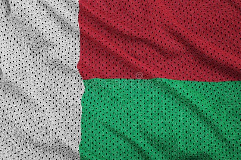 Madagascar flagga som skrivs ut på ett fab ingrepp för polyesternylonsportswear arkivfoton