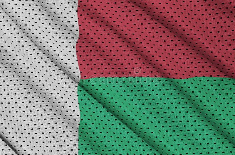 Madagascar flagga som skrivs ut på ett fab ingrepp för polyesternylonsportswear royaltyfri bild