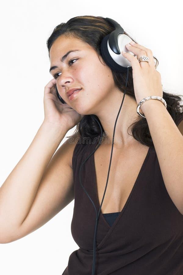 Madame avec des écouteurs image libre de droits