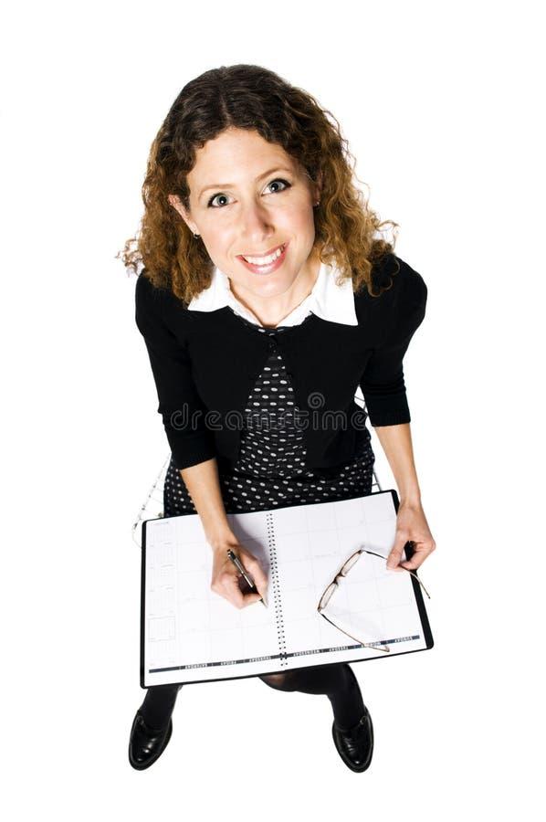 Madame avec le calendrier photos stock