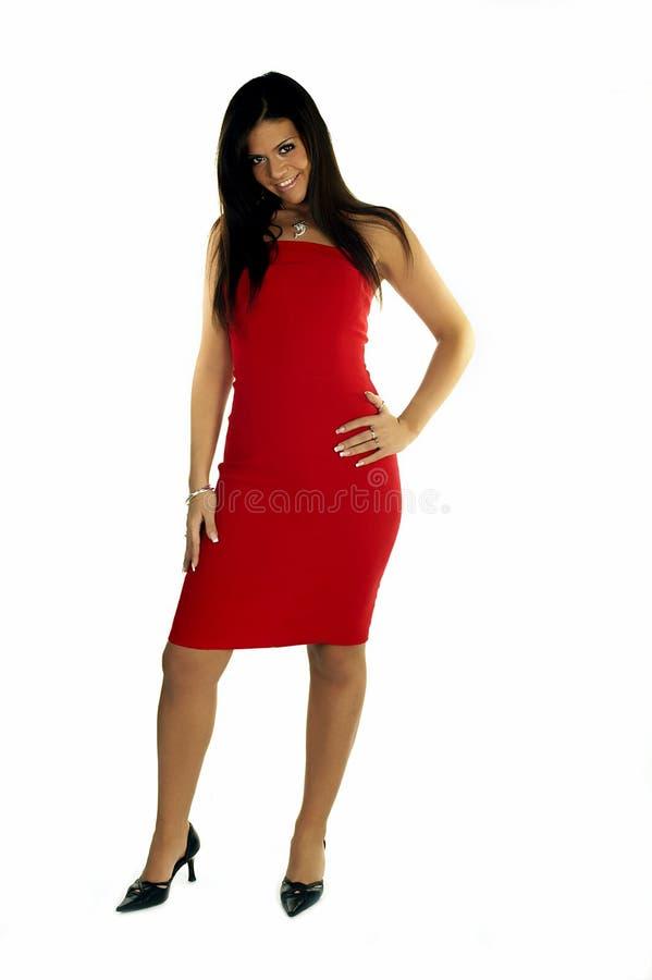 Madame dans la robe rouge image stock